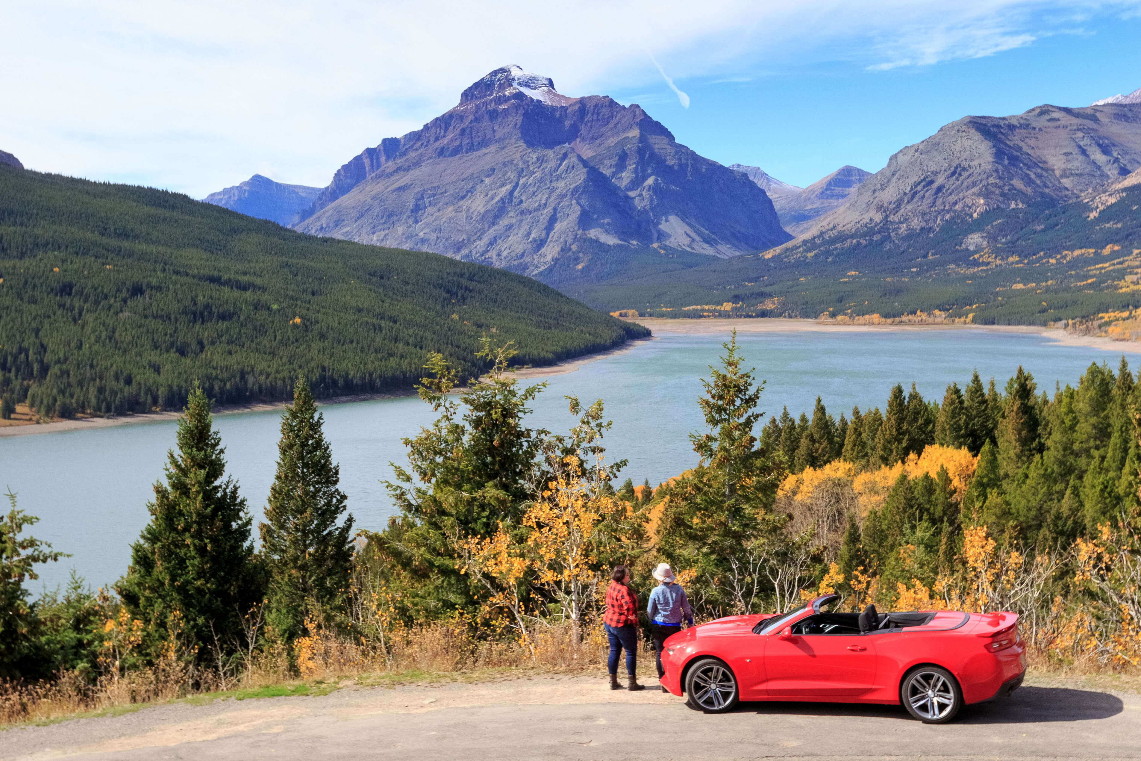 Visitors take in the view at East Glacier, Montana on a beautiful fall day.