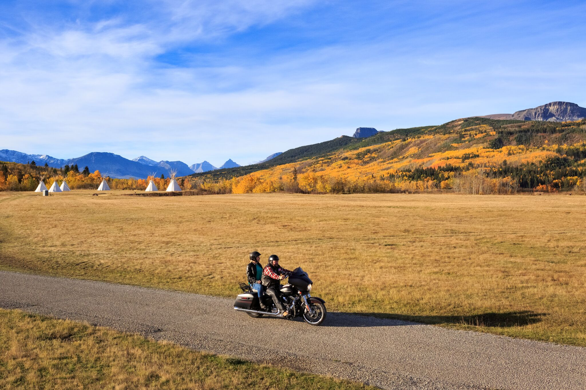 Visitors take a motorcycle ride in the fall near St. Mary, Montana in Glacier National Park.
