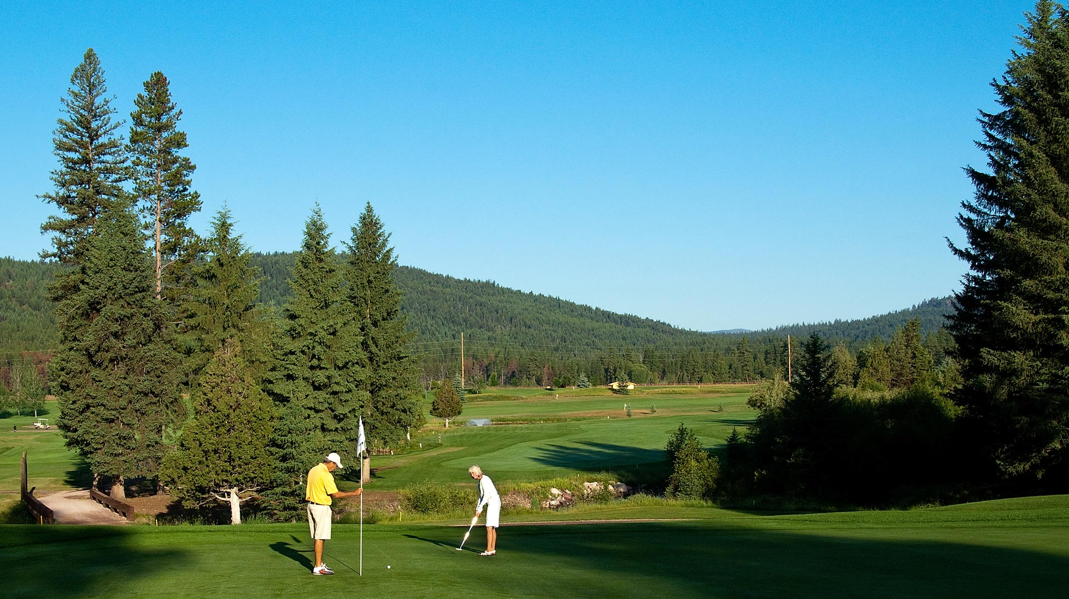 Take in the fall scenic views in Western Montana by playing a round of golf while admiring the Tamarack trees and snowcapped peaks.