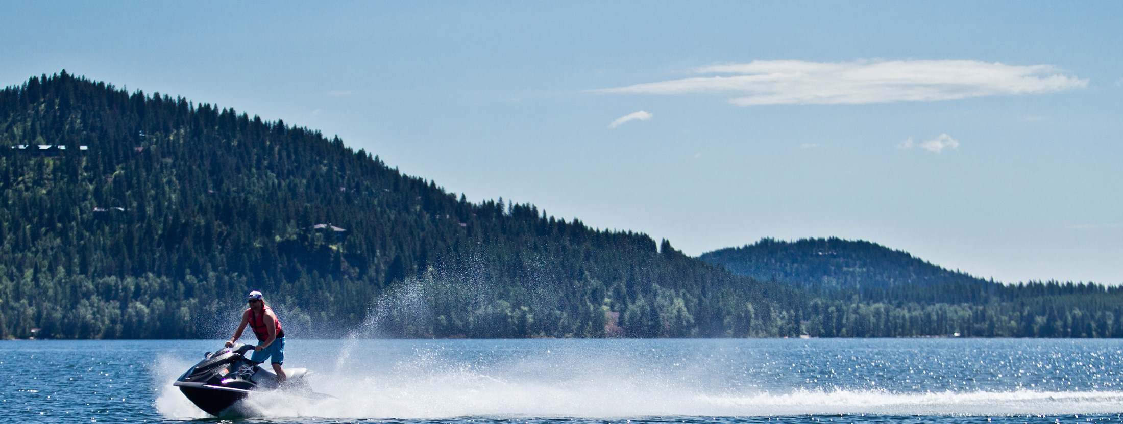 A jet skiier takes to a Western Montana lake in the fall.
